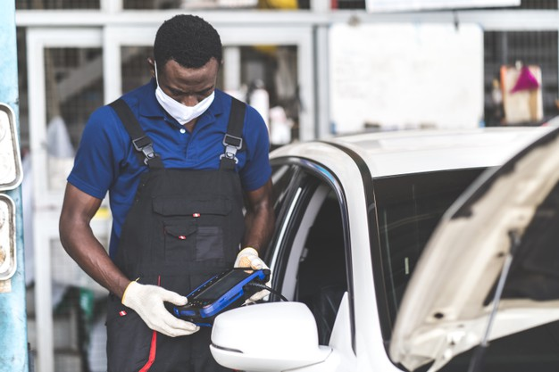 african-american-black-people-professional-car-mechanic-repair-service-checking-car-engine-by-diagnostics-software-computer_38052-275
